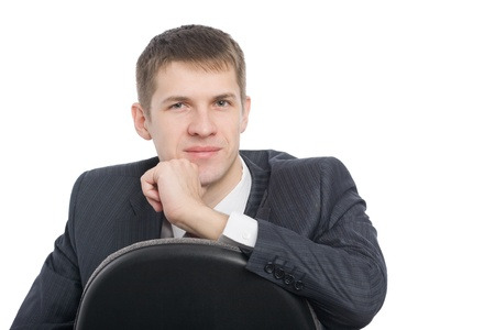 Pensive handsome young businessman. Isolated on white. Stock Photo - 10407913