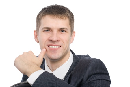 Portrait of a smiling handsome young businessman. photo