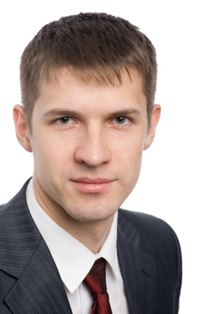 Portrait of a handsome young businessman with a slight smile on his face. photo
