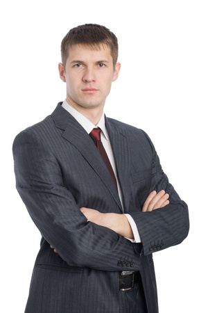 glance: Portrait of a handsome young businessman with a serious glance.