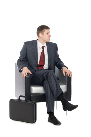 sideways: Awaiting a handsome young businessman. Stock Photo