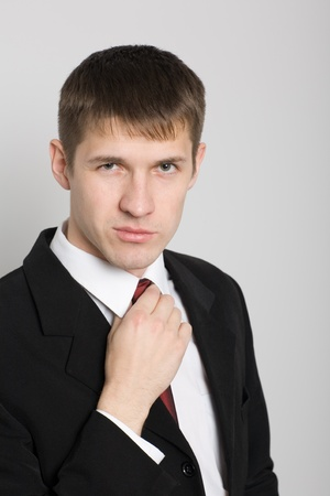 Handsome young businessman with a thoughtful glance. Stock Photo - 10407924