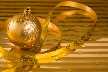 Christmas baubles(ball,ribbon,stars) on a gold background. photo