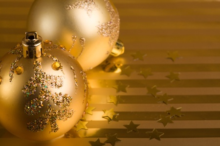Christmas balls on a gold background. photo