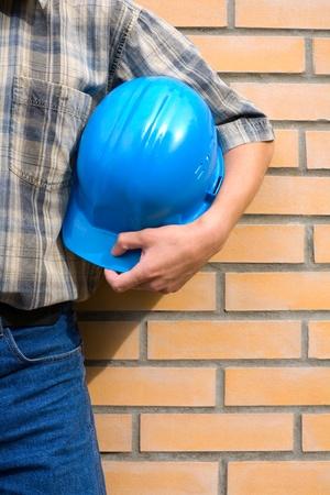 The mason on a background of a brick wall. photo