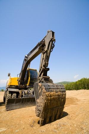 excavator on a working platform photo