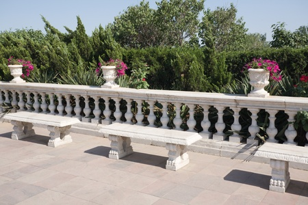 Benches from a granite in park photo