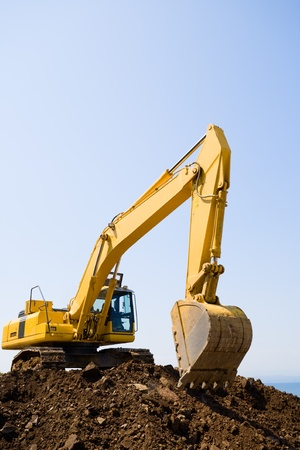 excavator on a working platform Stock Photo