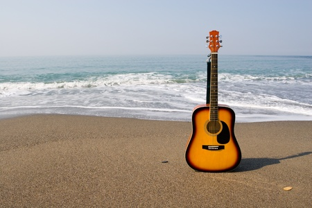 Guitar on coast on a background of the sea. photo