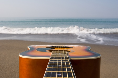 Guitar on a background of a sea wave. photo