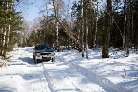 driving conditions: The automobile goes on snow-covered road in mountains.Winter.
