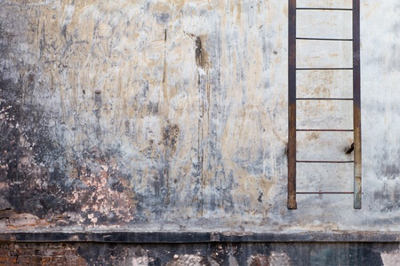 urban decline: Wall of an old house with a ladder. Stock Photo