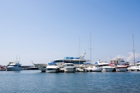 Yachts at a mooring in harbour. photo