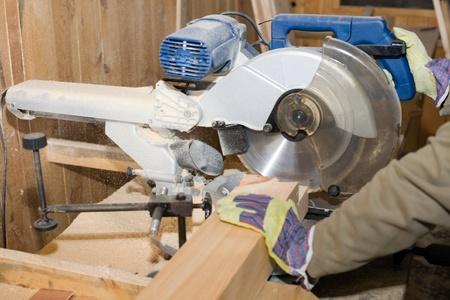 carpenter's sawdust: A carpenter(sawman) at work.