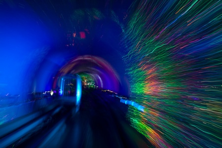 The abstract image of running fires in the tunnel. Shanghai. June, 2009. photo
