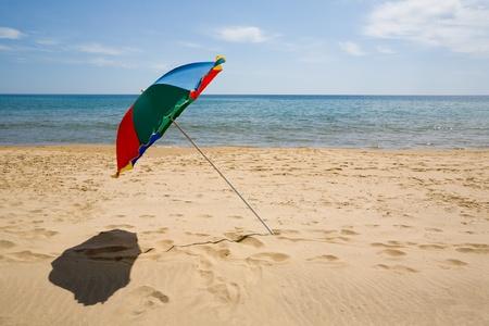 Color umbrella on a sandy beach. photo
