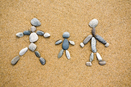 Pictogram.Family from a pebble on sand. Stock Photo - 10531568
