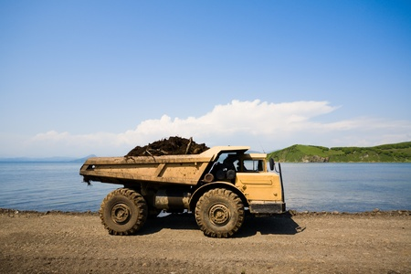 dump truck on a background of the sea photo