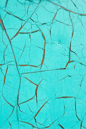 The cracked paint on metal. photo