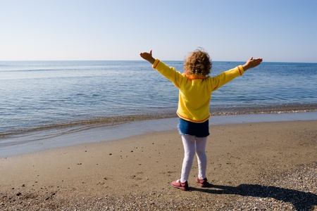 admired: The little girl is admired by sea.