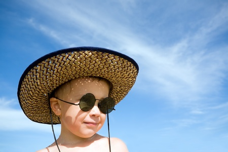 sunglassess: boy  on a background of the sky