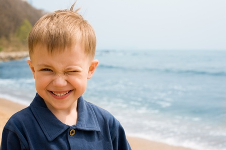smiling boy on a background of the sea.boy 4 years photo