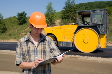 Road inspector on a working platform. Stacking of new asphalt. Stock Photo - 10531843