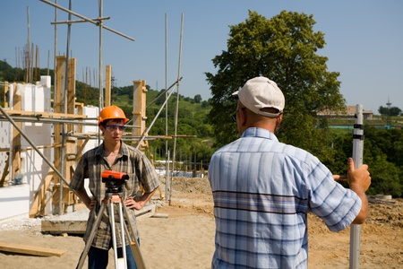 Young builder on a building site Stock Photo - 10531831