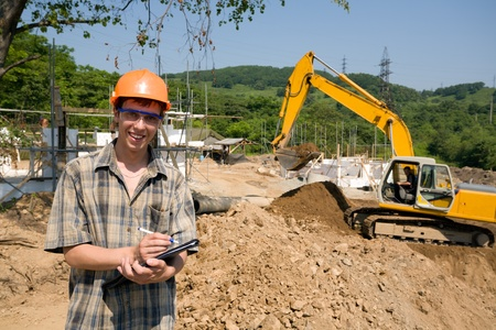 Builder inspector on a working platform.On a background a excavator. Stock Photo - 10531941
