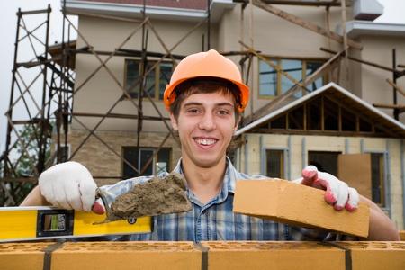 Mason builds a brick wall. Stock Photo - 10531830