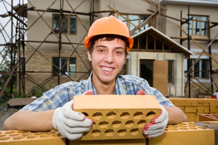 Mason on construction of a house. photo