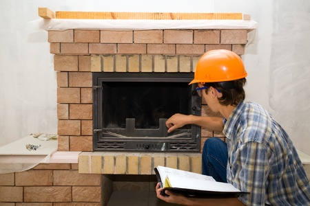 stone fireplace: Building  inspector examines a new fireplace