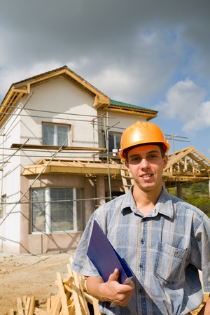 residential construction: The building inspector on a working platform. Stock Photo
