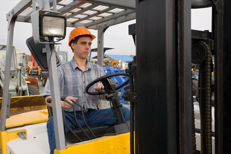 Operator  working on the forklift photo