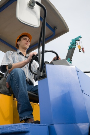 Operator  operates a steamroller.  photo