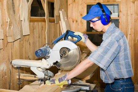 Carpenter(sawman) at work. photo