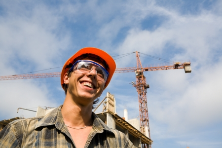 Young builder on a building site. photo