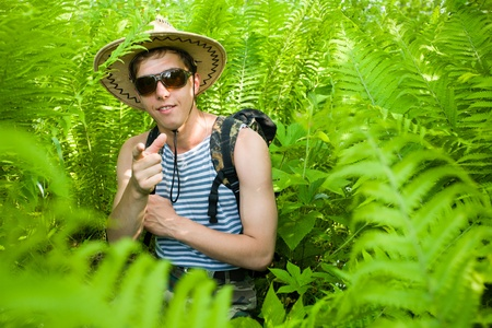 The young hiker in thrickets ferns.Laughter photo