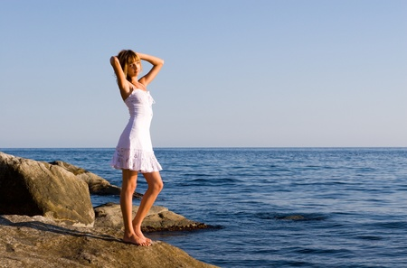 Girl.Sea. Evening.Summer. Stock Photo - 10546491