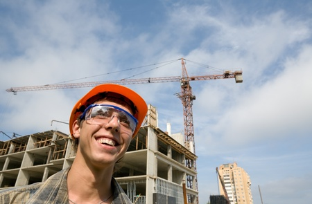 Young builder inspector on a background of building object. photo