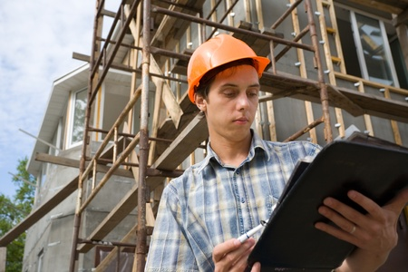 building safety: Building inspector on a working platform.