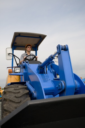 Construction worker driving a bulldozer on a building site photo