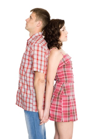Girl and boy standing back to back. Isolated on white. Stock Photo - 10551441