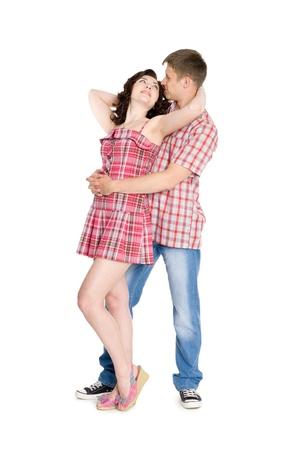 Guy hugs the girl behind. Isolated on white. photo