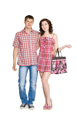 Happy young embracing couple standing on full length. photo