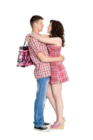 Girl with a bag hugs your favorite guy. photo