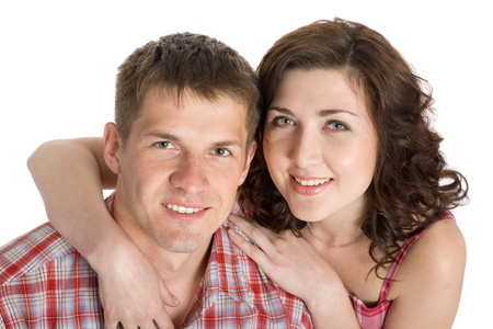 Portrait of a young couple in love. Isolated on white. photo