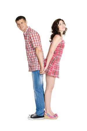 Young man and woman facing each other back in full length. photo