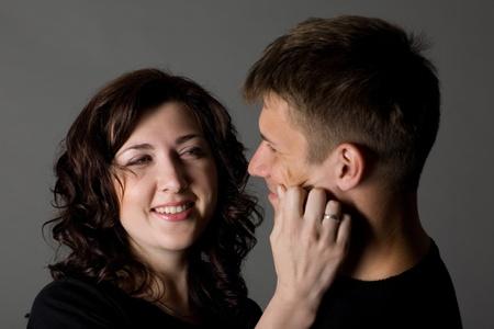 A happy young couple on a gray background. photo