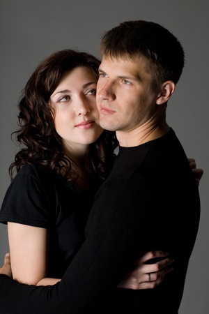 Portrait of a young couple on a gray background. Stock Photo - 10556281